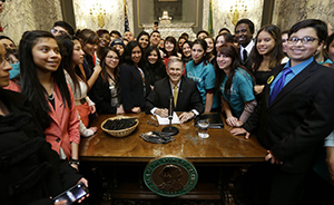 Governor Jay Inslee signs the Dream Act (Real Hope Act). Photo by the Seattle PI. Governor Jay Inslee signs the Dream Act (Real Hope Act). Photo by the Seattle PI.