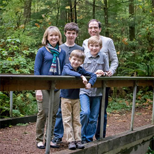 Beth Sigall with her family. Clockwise from top left: Beth, Anthony, Jule, Thomas, and Joseph.