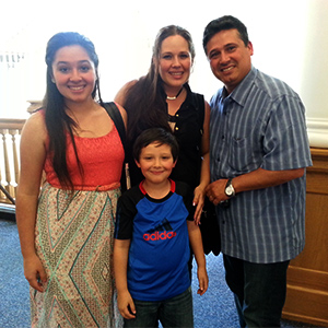The Guerra family at the June 6 State Board of Education forum. From left: From left to right, Ashley, her younger brother Julito, her mom Yelenys, and her dad Julio.