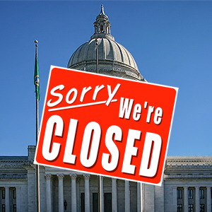 "Image of the Washington State Capitol Building with a ""Closed"" sign."