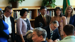 Governor Jay Inslee signs Opportunity Gap House Bill 1541 into law, with (l-r) Rep. Lillian Ortiz-Self, Rep. Sharon Tomiko Santos and Rep. Tina Orwall