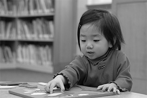 A toddler plays with a puzzle.