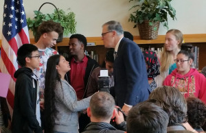 Governor Jay Inslee congratulates Aki Kurose Middle School students after he signed Opportunity Gap HB 1541